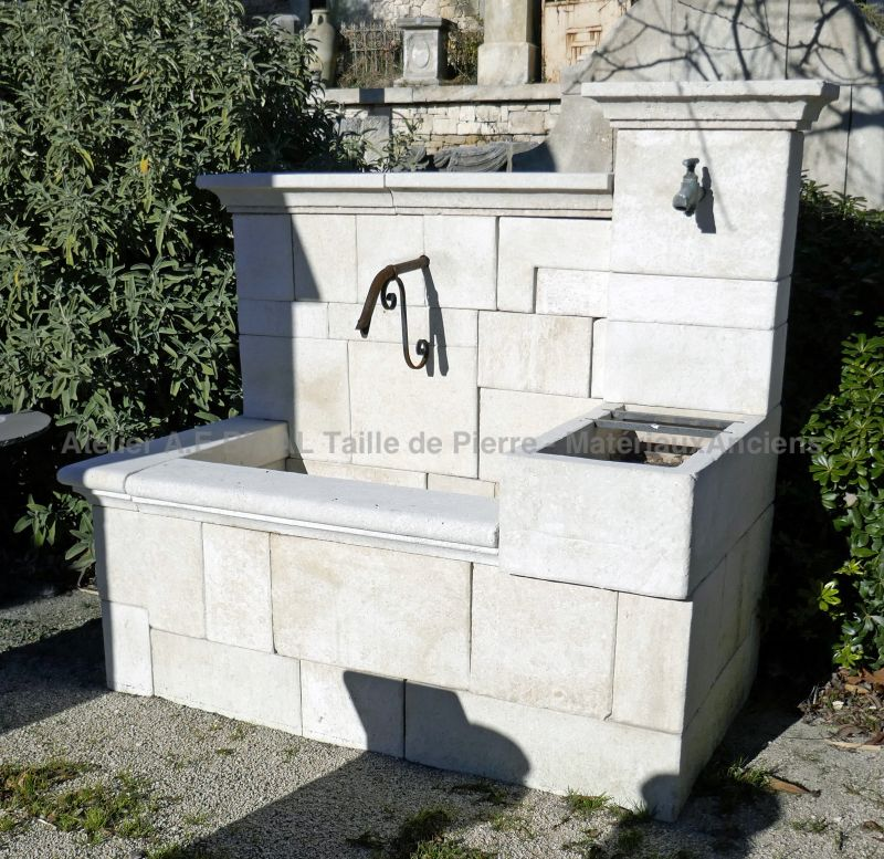 Provencal fountain hand carved in a white limestone - A wall fountain signed Atelier Alain Bidal.