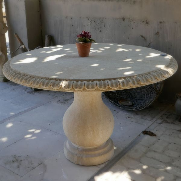 Garden table | Stone table for outdoors use by stonemason Alain Bidal.
