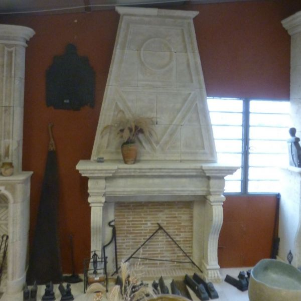 Fireplace in stone with an overmattle, carved in a Provence Style