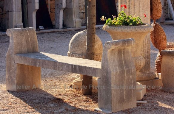 Stone bench with armrests of the Alain Bidal stone cutting workshops in Provence.