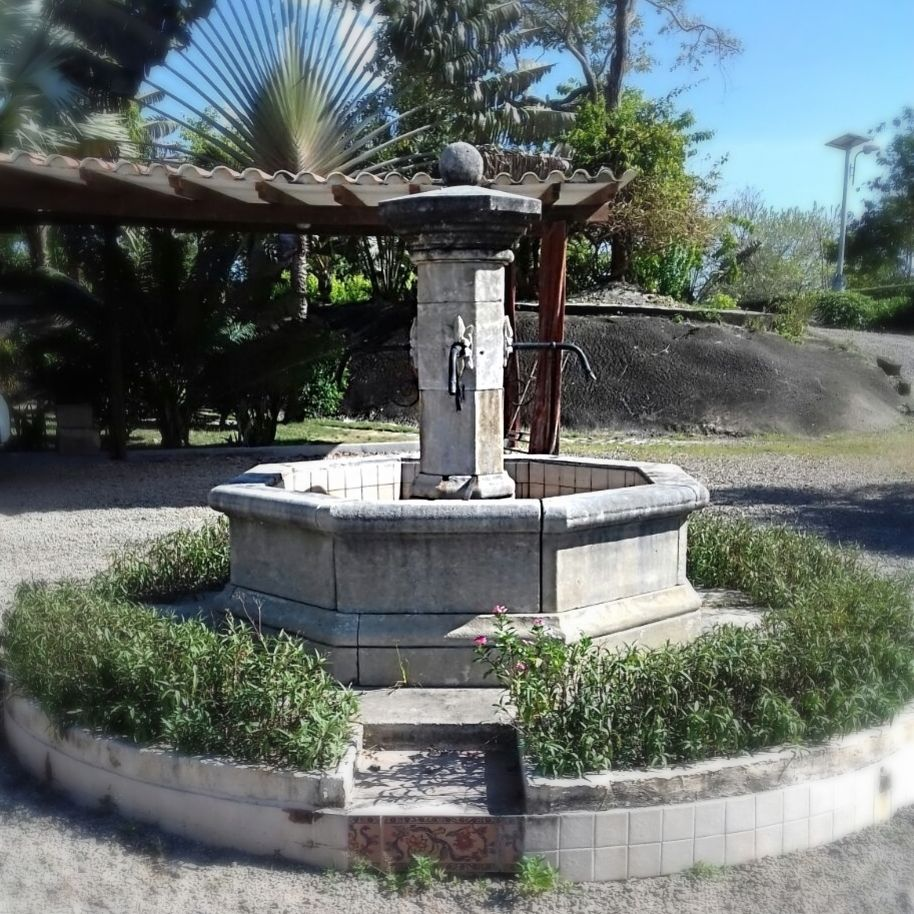 Hand-made Provencal stone fountains | Octagonal stone fountain made by Alain Bidal workshop in Provence.
