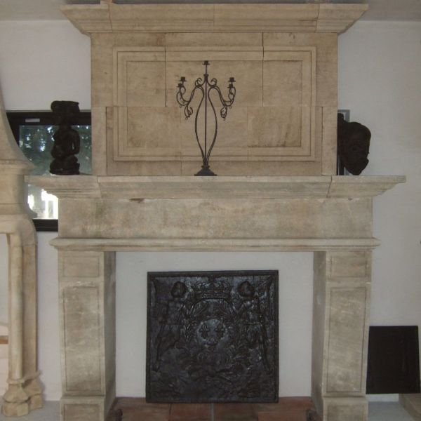 Stone fireplace, new craft edition of a fireplace in Louis XV style,