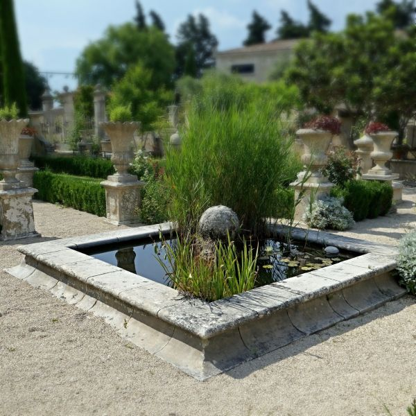 Beautiful garden pond in natural stone - A stone basin for outdoor design.