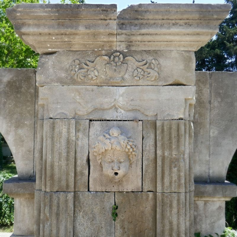 Pediment very finely hand-carved from our natural limestone wall fountain on sale at Alain Bidal in Provence.