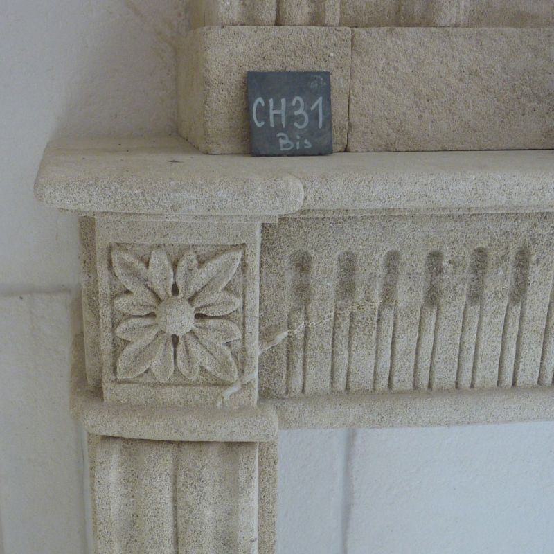 eye catching detail sculpted on the fireplace in stone inspired by louis XVI style of the Bidal Workshop
