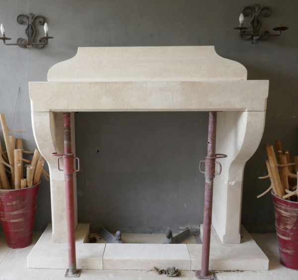 Limestone fireplace made in Provence by the master craftsman Alain Bidal, stonemason.
