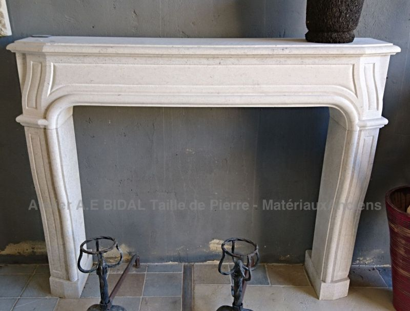 Fireplace of the Louis XIV style, made in the Massangis stone, a Bourgogne limestone.