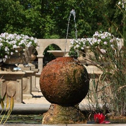 Ball sculpted on a garden pond - work by a stone mason from Vaucluse