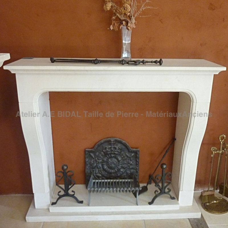 Provence-style fireplace in Lens limestone made by a Master Stone mason from Vaucluse.