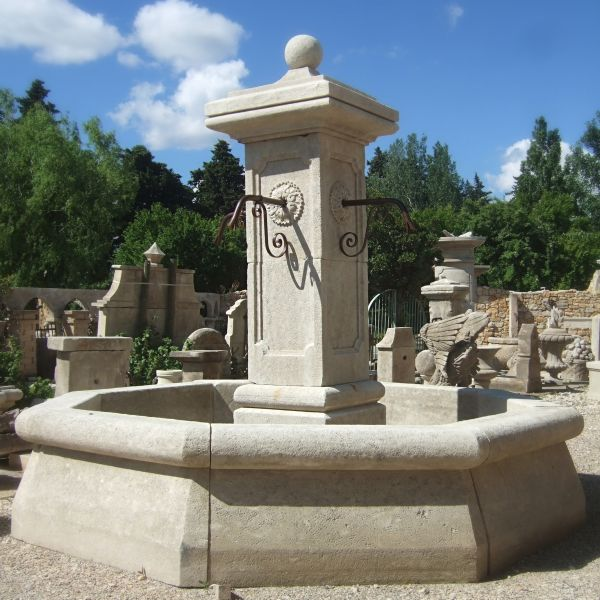 Centrale fountain in Freestone,made  by Alain Bidal's Provence Workshop of the stone