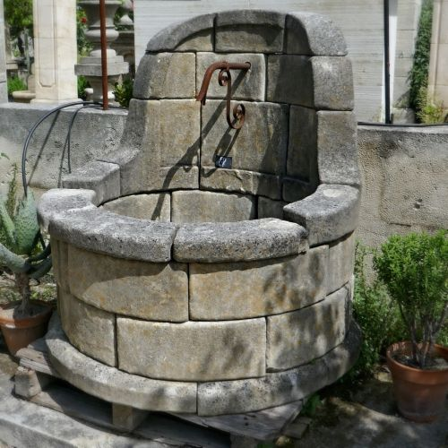 Provence ornamental fountain crafted in natural limestone by the craftsman Alain Bidal.