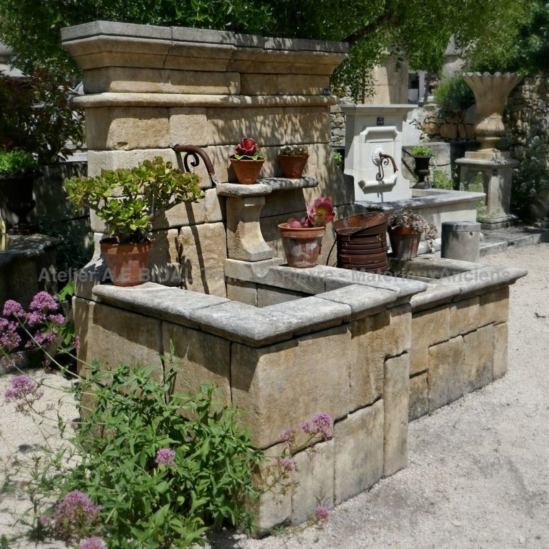 Embellish your garden with a real natural stone fountain on sale in Provence at Atelier Alain BIDAL.