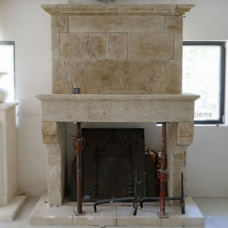 Antique fireplace in stone with trumeau - Fireplace for insert by Atelier Bidal in Vaucluse.