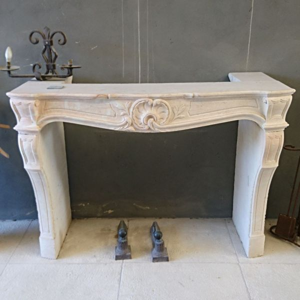 Louis XV-style fireplace in Burgundy stone - handmade in Provence.