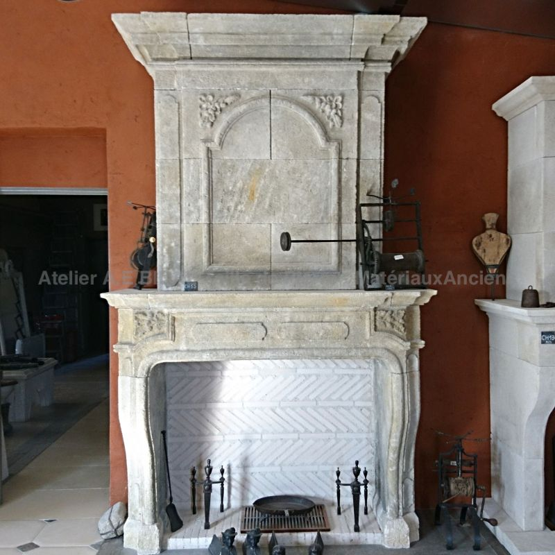fireplace in a Louis XIV style in natural stone ( inspired by the 17th/ 18th centure