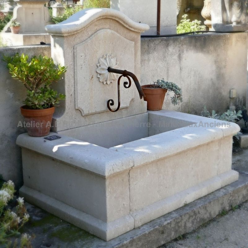 Outdoor fountain in stone made by the craft firm Bidal, stone masons in Provence.