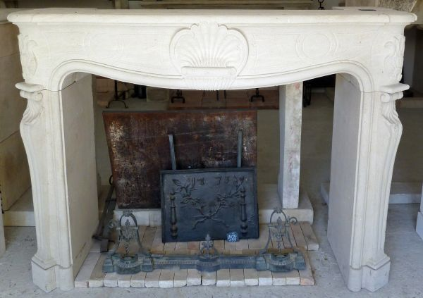 Fireplace hand carved in stone by Alain BIDAL, stone cutter in Provence.