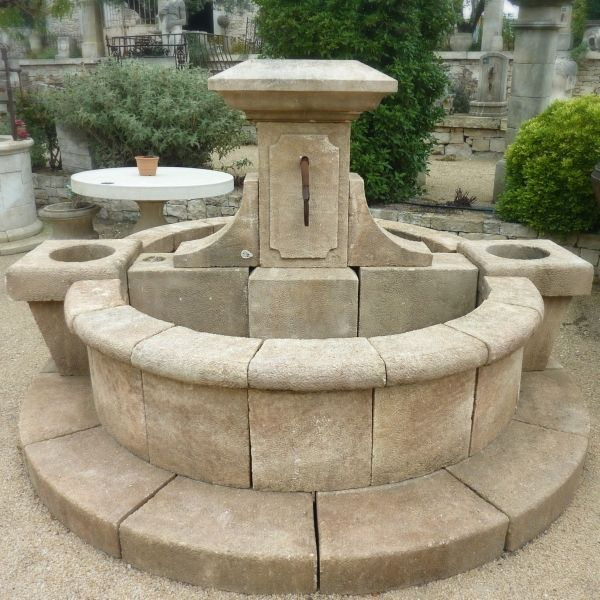 Traditionnal Provencal village fountain carved in stone made for outdoor decoration