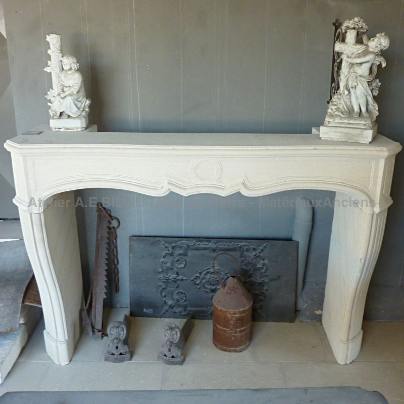 Here is our limestone fireplace inspired by the Louis XV - Louis XVI styles.