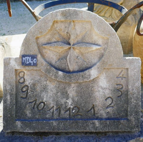 Sundial in Provence limestone by the stone cutter of Provence Alain BIDAL.
