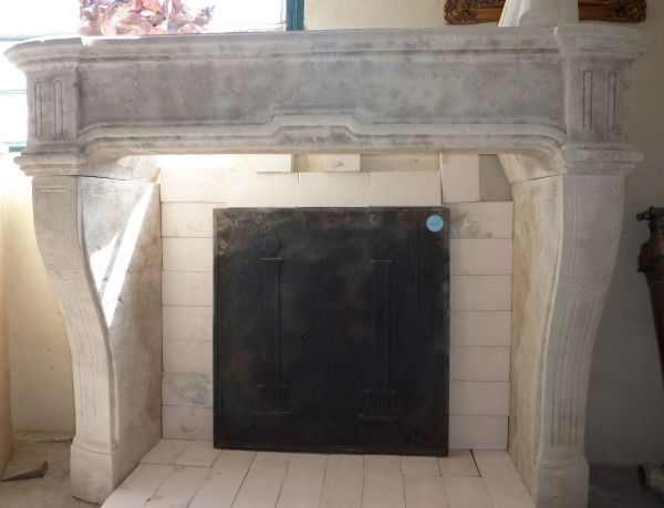 Fireplace in natural limestone, a fireplace crafted in a stone extarcted in Provence.