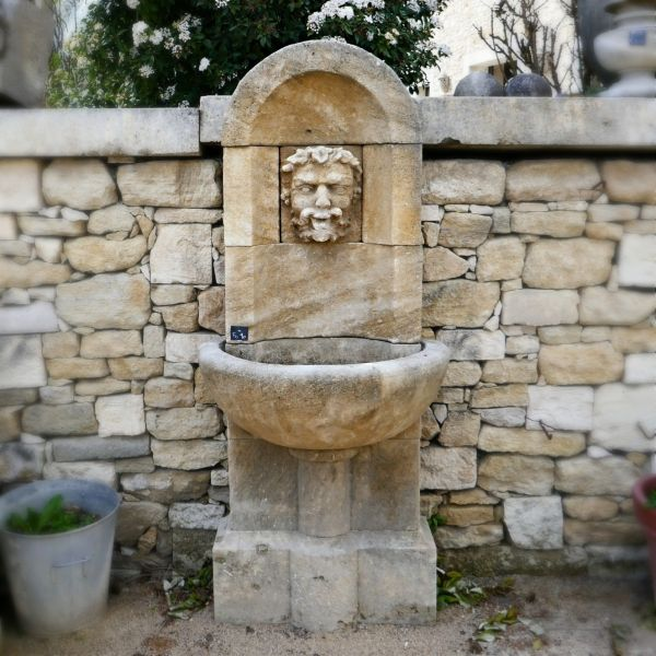 Garden wall fountain crafted in Estaillades stone and created by Alain BIDAL.