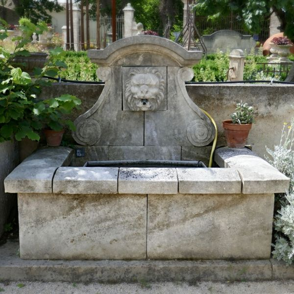 Wall fountain for garden in a natural unfreezable stone.